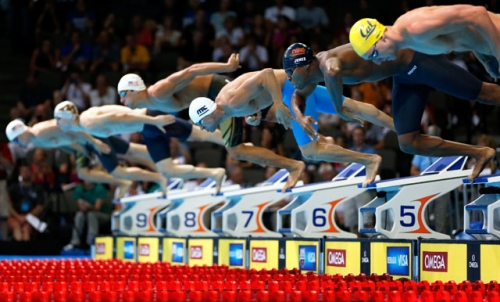 r dives off of the starting block as he competes in preliminary heat 16 of the mens 50 m freestyle during day six of the 2012 us olympic swimming