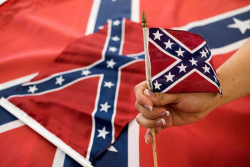 An Employee Holds Up A Confederate