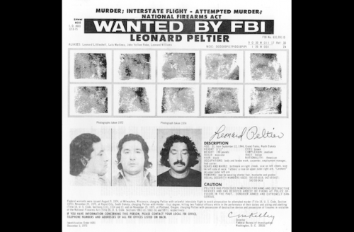 """Black and White FBI """"Wanted"""" poster, fingerprint images and pictures of Leonard Peltier with long hair"""