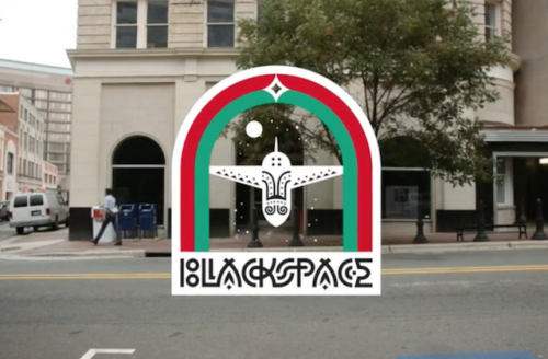 """""""Blackspace"""" in white text with white airplane, green and red arches, cityscape in the background"""
