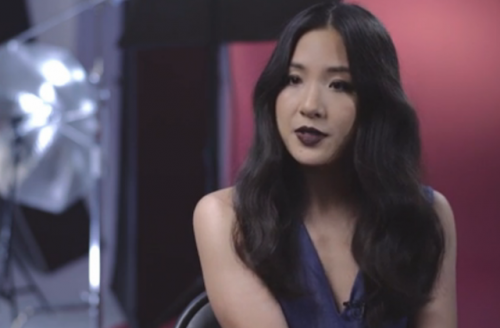 Constance Wu in purple top, red background