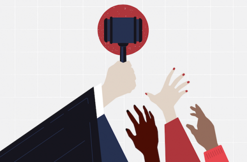 A White hand holds a gavel above hands of other skintones