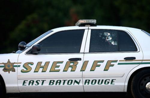White police car with green and gold lettering