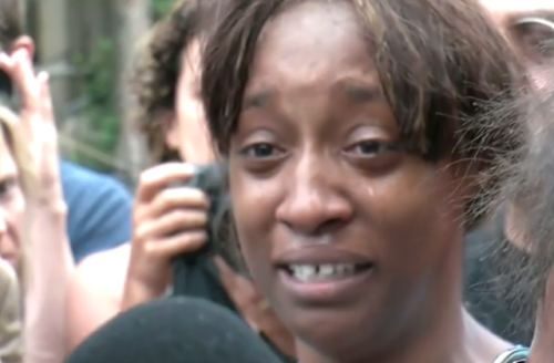 "Lavisha ""Diamond"" Reynolds, crying, surrounded by media"