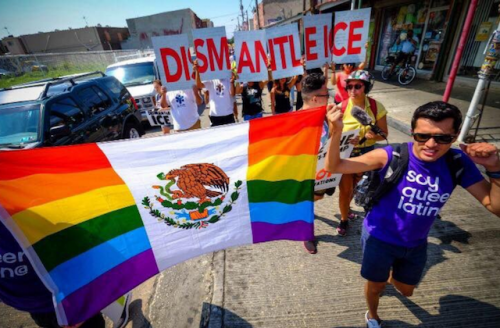 """rainbow/Mexican flag and sign reading """"Dismantle ICE"""" in red text with white background"""