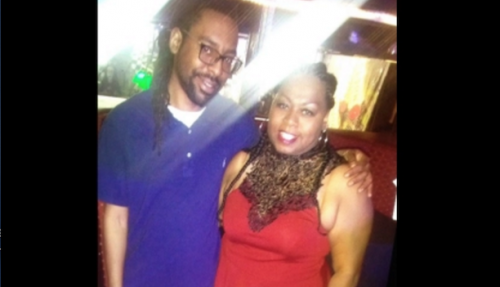 Philando Castile, wearing a blue polo shirt, stands smiling with his mom, Valerie, who is also smiling.