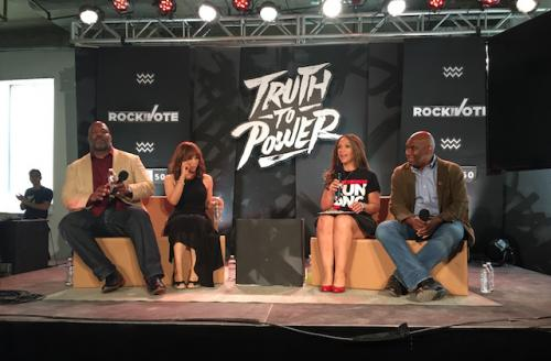 "Panelists in front of black background with white text reading ""TRUTH TO POWER"""