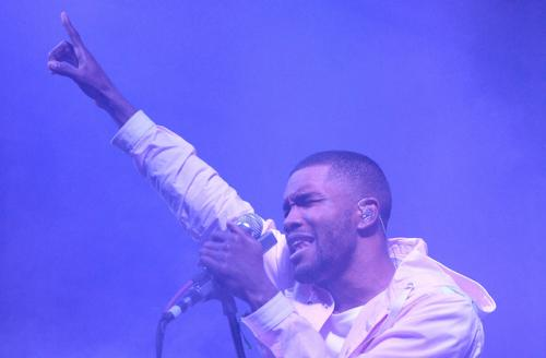 Frank ocean in white outfit with purple lights