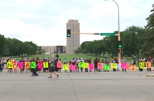 Colorlines screen shot of NBC video of Sioux protesting at the capitol, taken on August 22, 2016.