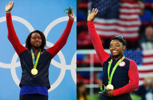 Simone Manuel and Simone Biles in red and navy warm-ups with gold medals on green ribbons