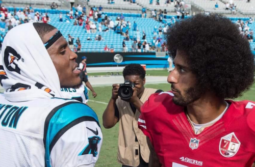 Cam Newton in white jersey with black and blue lettering next to Colin  Kaepernick in red 73aaed7d5