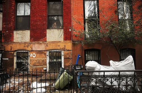 Two homes sit side-by-side in the Fort Greene neighborhood in Brooklyn, New York.