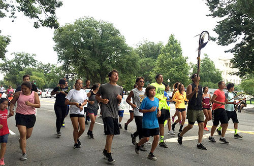 """The Oceti Sakowin Youth ran from the Supreme Court to the Army Corps of Engineers' Headquarters chanting, """"We run, For our people, For one nation, We run, For water, For life, We run!"""""""