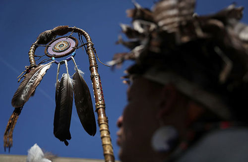 A Native American tribe member participates during a rally on the Dakota Access Pipeline August 24, 2016, outside U.S. District Court in Washington, DC. Activists held a rally in support of a lawsuit against the Army Corps of Engineers.