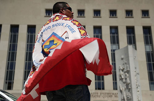 Wiyake Eagleman of the Rosebud Sioux Tribe participates during a rally on Dakota Access Pipeline August 24, 2016, outside U.S. District Court in Washington, DC. Today, the judge finally filed a motion to deny the tribe's request to end construction.