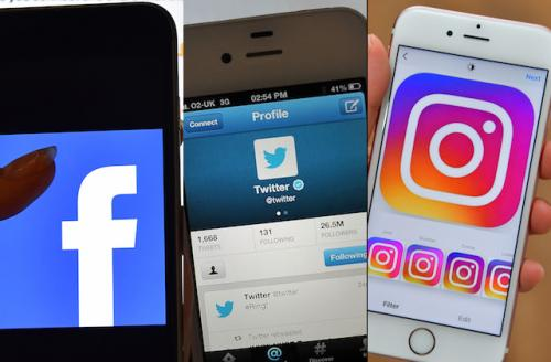 iPhones with Facebook, Twitter and Instagram icons on them