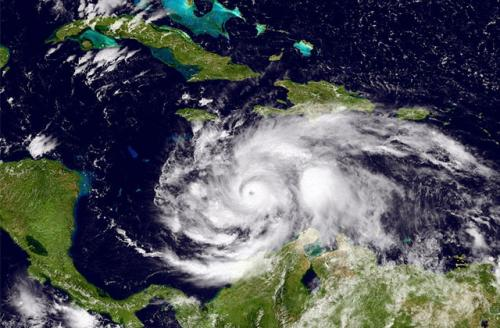 This NOAA image, taken by the GOES satellite at UTC: 1803Z, shows Hurricane Matthew in the Caribbean Sea just south of Cuba and Jamaica on October 2, 2016. Matthew is a strong Category 4 hurricane in the central Caribbean Sea.