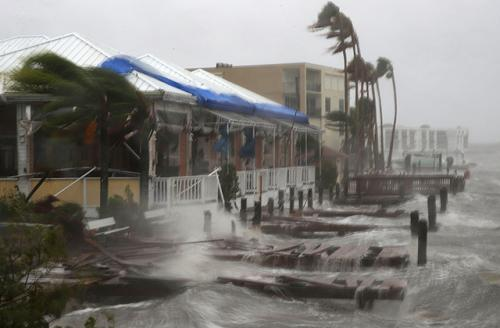 Heavy waves caused by Hurricane Matthew pounds the boat docks at the Sunset Bar and Grill, October 7, 2016, on Cocoa Beach, Florida. Hurricane Matthew passed by offshore as a Category 3 hurricane bringing heavy winds and minor flooding.