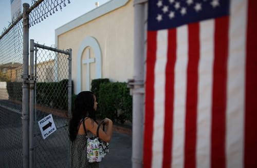 A woman enters a polling place in the heavily Latino East L.A. area during the 2012 U.S. presidential election.