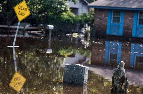 A graveyard is inundated with floodwaters from the Lumber River on October 15, 2016, in Lumberton, North Carolina. The flooding caused by Hurricane Matthew has been responsible for 26 deaths in the state.