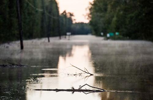 A roadway is flooded by remnants of Hurricane Matthew on October 11, 2016, near Dillon, South Carolina. The region is still assessing the full magnitude of damage caused by the storm.