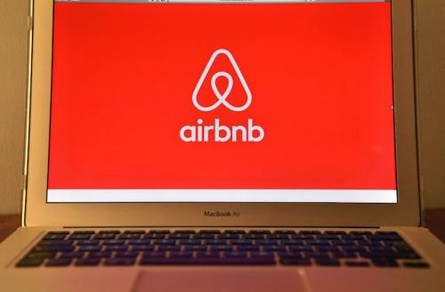 Airbnb logo on laptop screen