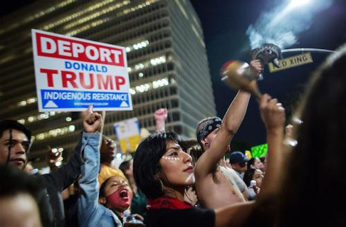 Protestors hold signs on streets of Los Angeles