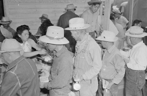 Japanese-American men lined up for food