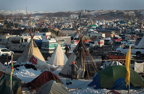 Hawk Laughing, a Mohawk originally from northern New York, helps to build a tipi at Oceti Sakowin Camp on the edge of the Standing Rock Sioux Reservation on December 3, 2016, outside Cannon Ball, North Dakota.