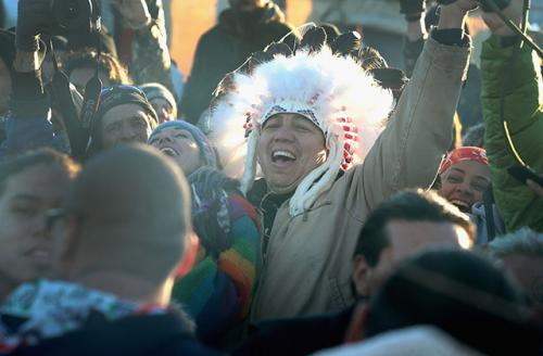 Native American and other activists celebrate after learning an easement had been denied for the Dakota Access Pipeline at Oceti Sakowin Camp on the edge of the Standing Rock Sioux Reservation on December 4, 2016, outside Cannon Ball, North Dakota.