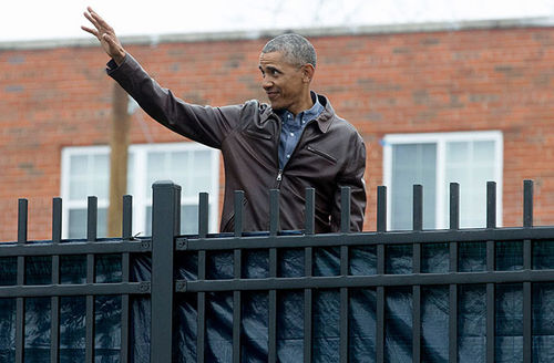 President Barack Obama waves to local people cheering for him after attending a service event for Martin Luther King Jr. Day at the Jobs Have Priority Naylor Road Family Shelter January 16, 2017, in Washington, D.C.