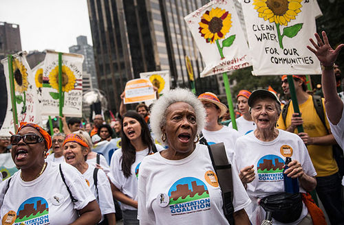 People protest for greater action against climate change during the People's Climate March on September 21, 2014, in New York City. Another march is planned for April 29 in Washington, D.C.