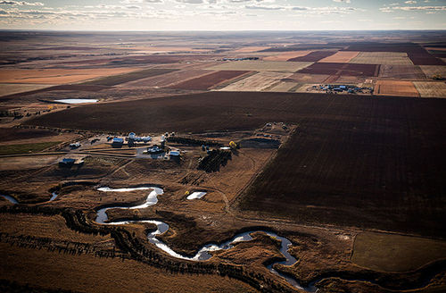 A creek weaves through the rolling hills of South Dakota near the land where the proposed Keystone XL pipeline would pass on October 13, 2014, south of Pierre, South Dakota. This land could be impacted by a potential future spill if the pipeline happens.