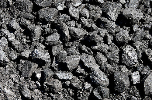 Pieces of coal sit on the ground at the Savage Energy Terminal on August 26, 2016, in Price, Utah.