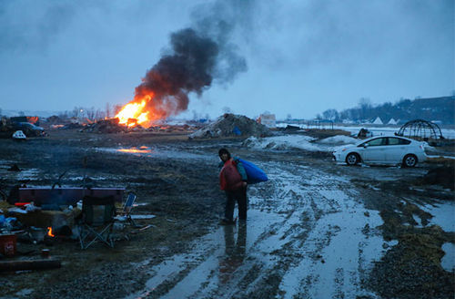 Campers set structures on fire in preparation of the Army Corp's 2 p.m. CT deadline to leave the Oceti Sakowin protest camp on February 22, 2017, in Cannon Ball, North Dakota.