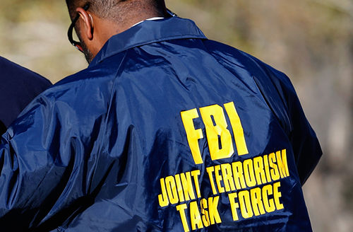 Members of the FBI Joint Terrorism Task Force stand outside of a press conference regarding the San Bernardino, California, shooting on December 2, 2015.
