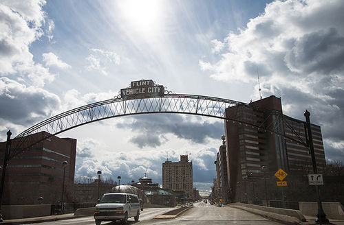 """General view of downtown Flint, Michigan, as well as the famed arches bearing the city's nickname """"Vehicle City"""" on March 17, 2016."""