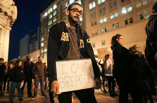 Young man holds sign at protest