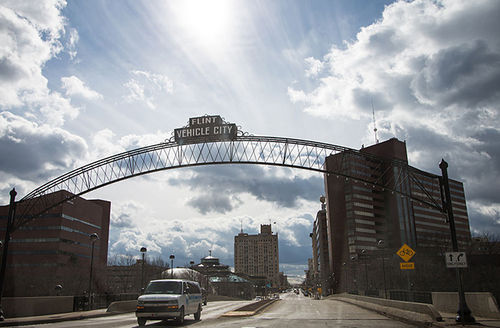 """General view of downtown Flint, as well as the famed arches bearing the city's nickname """"Vehicle City"""" on March 17, 2016, in Flint, Michigan. Flint continues to work through the effects of water contamination."""
