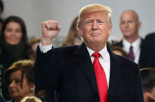 President Donald Trump waves to the crowd from the inaugural parade in front of the White House on January 20, 2017, in Washington, D.C.