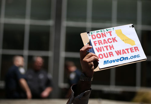 A protestor holds a sign during a demonstration against fracking in California on May 30, 2013.