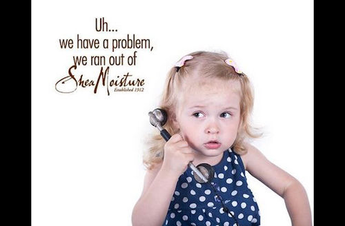 """Blonde toddler with confused look on face holds phone, text reads: """"Uh...we have a problem, we ran out of Shea Moisture."""""""