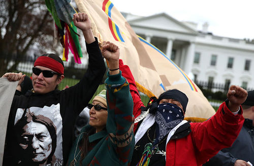 Protestors stand in front of the White House during a demonstration against the Dakota Access Pipeline on March 10, 2017, in Washington, D.C.
