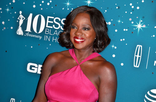 Black woman in pink dress in front of blue background with white text and images