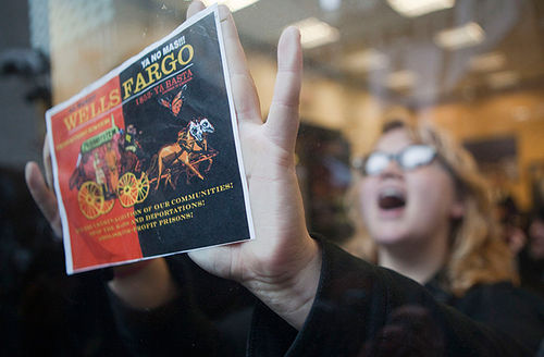 A demonstrator protests inside a Wells Fargo Bank branch November 17, 2011, in Portland, Oregon. Then, they were protesting its funding of private prisons. Now, they've gotten the city to divest from it due to its interests in the Dakota Access Pipeline.