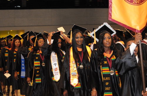 Black students in graduation garb.
