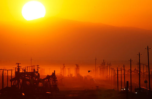 The sun rises over an oil field over the Monterey Shale formation where gas and oil extraction using hydraulic fracturing, or fracking, is booming on March 24, 2014, near Lost Hills, California.
