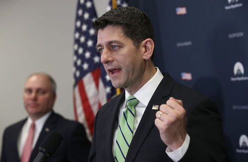 Paul Ryan. White man in a green tie.