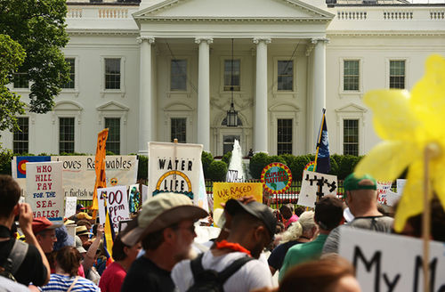 People march near the White House during the People's Climate March in Washington, D.C., April 29, 2017, to protest President Donald Trump's attack on the climate and the Environmental Protection Agency.