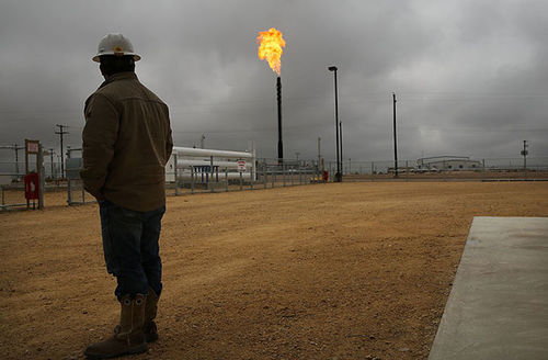 Flared natural gas is burned off at the Deadwood natural gas plant on February 5, 2015 in Garden City, Texas. Flaring is another way methane is released during natural gas drilling.
